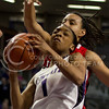 Sophomore guard Haley Texada fights for a shot above Utah sophomore guard Ciera Dunbar during the Wildcats' 54-46 loss to the visiting Utah Utes on April 3, 2013 in Bramlage Coliseum during the Semifinals of the Women's National Invitation Tournament (WNIT). [Jacob Dean Wilson | Collegian]