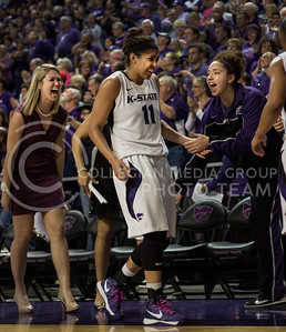 Junior guard Chantay Caron receives a standing ovation from the crowd and support from the Wildcat bench after scoring a career-high 19 points during K-State's 66-48 win over the visiting Illinois Fighting Illini on March 30, 2013 in Bramlage Coliseum during the Quarterfinals of the Women's National Invitation Tournament (WNIT). With the victory, the Wildcats' advance to the WNIT Semifinals and are set to face Utah on April 3rd in Bramlage Coliseum. [Jacob Dean Wilson | Collegian]