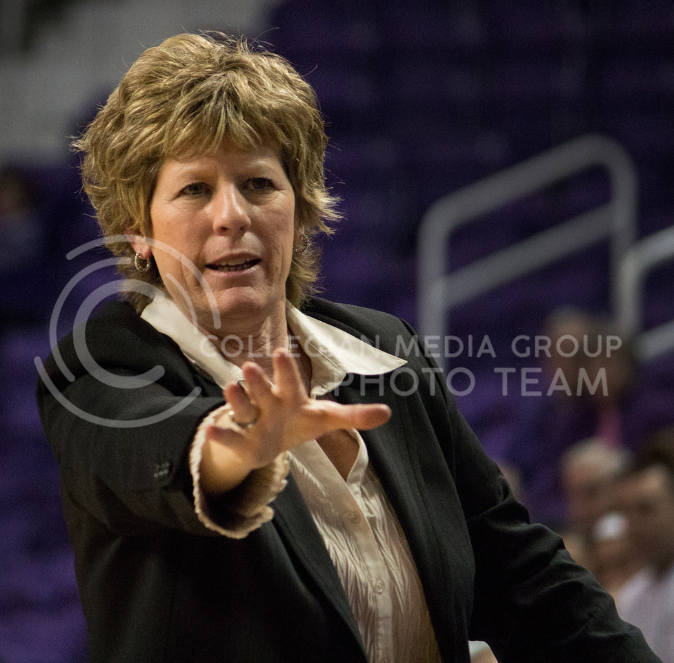 Head Coach Deb Patterson signals to her Wildcat team during their 60-48 victory over the visiting Ball State Cardinals on March 28, 2013 in Bramlage Coliseum during the third round of the Women's National Invitation Tournament (WNIT). With the victory, the Wildcats' advance to the WNIT Quarterfinals and are set to face Illinois on March 30, 2013 in Bramlage Coliseum. [Jacob Dean Wilson | Collegian]