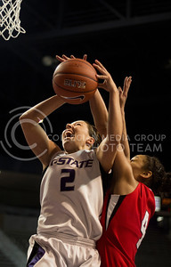 Senior guard Brittany Chambers is fouled during a shot by Ball State freshman guard Nathalie Fontaine during the Wildcats' 60-48 victory over the visiting Cardinals onMarch 28, 2013 in Bramlage Coliseum during the third round of the Women's National Invitation Tournament (WNIT). With the victory, the Wildcats' advance to the WNIT Quarterfinals and are set to face Illinois on March 30, 2013 in Bramlage Coliseum. [Jacob Dean Wilson   Collegian]
