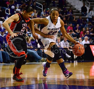 (Photo by Parker Robb  Collegian)  Senior guard Mariah White dribbles past a Texas Tech defender during her final home game with the Wildcats March 2 in Bramlage Coliseum. The Wildcats beat the Red Raiders 68-62 on Senior Day.
