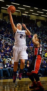 (Photo by Parker Robb  Collegian)  Senior guard Brittany Chambers launches toward the basket during the Wildcats' game against Texas Tech March 2 in Bramlage Coliseum. Chambers made five three-pointers in her final home game with the Wildcats.