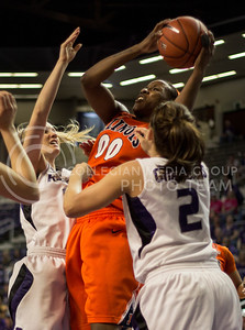 Illinois senior forward Karisma Penn jumps above K-State senior guard Brittany Chambers and sophomore guard Heidi Brown for a rebound during the Wildcats' 66-48 win over the visiting Illinois Fighting Illini on March 30, 2013 in Bramlage Coliseum during the Quarterfinals of the Women's National Invitation Tournament (WNIT). With the victory, the Wildcats' advance to the WNIT Semifinals and are set to face Utah on April 3rd in Bramlage Coliseum. [Jacob Dean Wilson | Collegian]