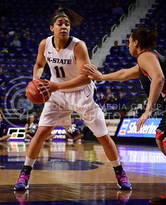 (Photo by Parker Robb  Collegian)  Junior forward Chantay Caron attempts to pass a Texas Tech defender during the Wildcats' final home game March 2 in Bramlage Coliseum. The Wildcats beat the Red Raiders 68-62 on Senior Day.