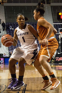 Sophomore guard Haley Texada drives against opposing Texas freshman guard Celina Rodrigo during the Wildcats' 68-47 victory over the visiting Longhorns on February 13th in Bramlage Coliseum. [Jacob Dean Wilson]