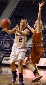 Senior guard Brittany Chambers passes the ball past opposing freshman guard Brady Sanders during the Wildcats' 68-47 victory over the visiting Longhorns on February 13th in Bramlage Coliseum. Chambers finished with a game-high 24 points. [Jacob Dean Wilson   Collegian]