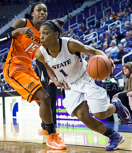 Haley Texada, Sophomore guard, drives though OSU defencer for 2 points. Haley ended the game with 14 points for the Wildcats, helping them beat OSU in overtime 76-70.