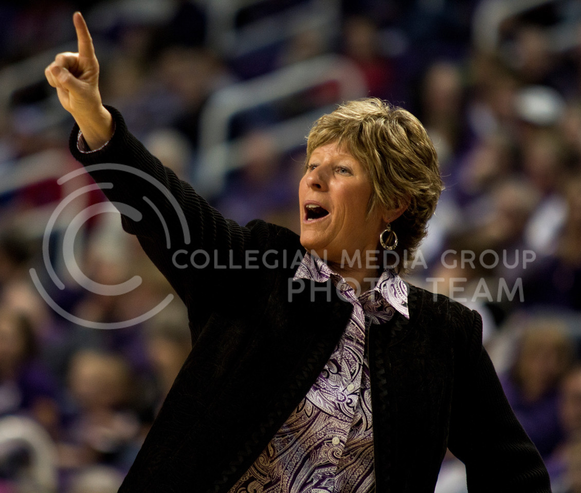 Head coach Deb Patterson signals to her team during the Wildcats' 89-80 double overtime loss to in-state rival Kansas on Feb. 2 in Bramlage Coliseum. [Jacob Dean Wilson]
