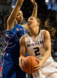 Senior guard Brittany Chambers attempts a shot under opposing Jayhawk junior guard CeCe Harper during the Wildcats' 89-80 double overtime loss to in-state rival Kansas on February 2nd in Bramlage Coliseum. [Jacob Dean Wilson]