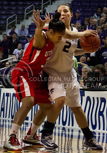 Senior guard Brittany Chambers works her way around Utah freshman guard Iwalani Rodrigues during the Wildcats' 54-46 loss to the visiting Utah Utes on April 3, 2013 in Bramlage Coliseum during the Semifinals of the Women's National Invitation Tournament (WNIT). [Jacob Dean Wilson   Collegian]