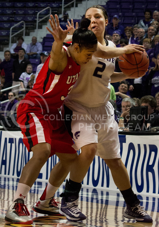 Senior guard Brittany Chambers works her way around Utah freshman guard Iwalani Rodrigues during the Wildcats' 54-46 loss to the visiting Utah Utes on April 3, 2013 in Bramlage Coliseum during the Semifinals of the Women's National Invitation Tournament (WNIT). [Jacob Dean Wilson | Collegian]