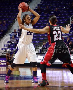 (Photo by Parker Robb| Collegian)  Senior guard Mariah White attempts to pass around a Texas Tech defender during her final home game with the Wildcats March 2 in Bramlage Coliseum. The Wildcats beat the Red Raiders 68-62 on Senior Day.