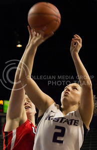 Senior guard Brittany Chambers shoots over Utah junior forward Taryn Wicijowski during the Wildcats' 54-46 loss to the visiting Utes on April 3, 2013 in Bramlage Coliseum during the Semifinals of the Women's National Invitation Tournament (WNIT). Chambers scored a team-high 16 points in her final game as a Wildcat. [Jacob Dean Wilson   Collegian]