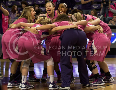 "The Kansas State women's basketball huddles up prior to their 50-69 loss to Iowa State on February 23rd in Bramlage Coliseum. The Wildcats' wore special pink uniforms to participate in the ""Play4Kay"" national initiative for breast cancer awareness. [Jacob Dean Wilson 