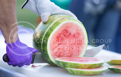 Watermelon was provided at the watermelon feed held on Weber lawn on Tuesday evening. Students were invited to come and enjoy the free watermelon feed put on by the College of Agriculture.  Kate Hagans I Collegian