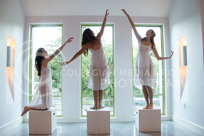 (Photo by Minh Mac / Collegian)  Meredith Olds, senior in dance major, Alana Pfeifer, senior in dance major, and Emma Wilson, junior in interior design, perform Seen and Unseen.  Night of Wonder exhibit was a performing-art exhibit in The Beach Museum of Art, held on Friday, Sept. 20, 2013. The exhibit featured both student and professional performers from around the country.