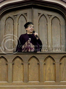 Josh Staab // The Collegian  Dean of K-State Libraries, Lori Goetsch, gathers the attention of the four houses and announces that the feast may begin from atop of the Great Room balcony.  Yesterday's Back to School Harry Potter Feast was on of the few times the decorative balcony has been used.