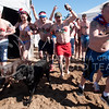 "Hannah Hunsinger | The Collegian Members og the ""Mightly Flunans"" charge down the beach to plunge in the 32.5 degree waters of the Tuttle Creek State park on Feb 22 at the Polar Plunge."