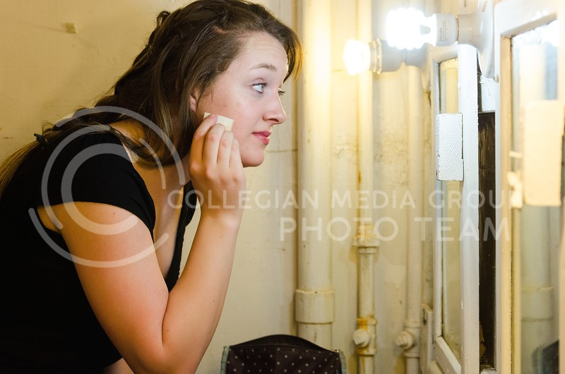 "Parker Robb | The Collegian  4:51 PM: Shannon Madden, junior in musical theater, who plays Crystal in ""Of Platypuses and Nuts,"" applies makeup to her face prior to the cast's dress rehearsal April 12, 2014."
