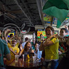 (Photo by Taylor Alderman | Collegian)<br /> <br /> Brazil fans celebrating after watching Brazil defeat Croatia at a Brazil World Cup watch party at Tanner's Bar and Grill last Thursday.