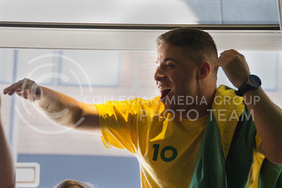 (Photo by Taylor Alderman | Collegian)  A Brazil fan celebrating at a World Cup watch party at Tanner's on June 12, 2014.