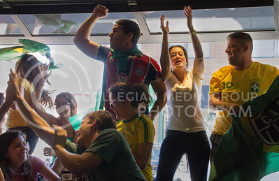 (Photo by Taylor Alderman | Collegian)  Brazil fans celebrating during a World Cup watch party at Tanner's on June 12, 2014.