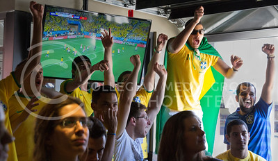 (Photo by Taylor Alderman | Collegian)  Brazil fans reacting to the soccer game against Croatia during a World Cup watch party at Tanner's Bar and Grill on June 12, 2014.
