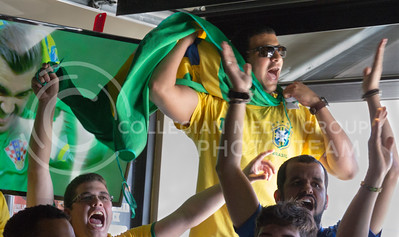 (Photo by Taylor Alderman | Collegian)  Joao Neto, exchange student in agronomy, Daniel Abreu, exchange student in civil engineering, and Galdesson Santos, exchange student in architecture, celebrating during the Brazil versus Croatia game at a World Cup watch party at Tanner's on June 12, 2014.