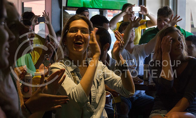 (Photo by Taylor Alderman | Collegian)  Brazil fans celebrating during the soccer game against Croatia at a World Cup watch party at Tanner's Bar and Grill on June 12, 2014.