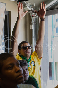 (Photo by Taylor Alderman | Collegian)  Daniel Abreu, exchange student in civil engineering, raises his arms up in anticipation while watching Brazil play against Croatia. Brazil fans gathered at Tanner's Bar and Grill on June 12, 2014 for a World Cup watch party.