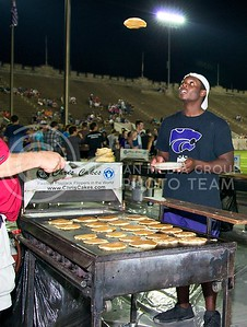 (Photo by Jed Barker | Collegian) Marcus Sheppard, sophomore in political science, attempts to catch the pancake flipped to him during the annual pancake feed at the Old Stadium on Saturday night, August 24, 2013.