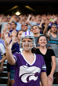 Cassie Daldrup waves the Wildcat Claw during the K-State Kickoff in Bill Snyder Family Stadium on Sunday, August 25, 2013.