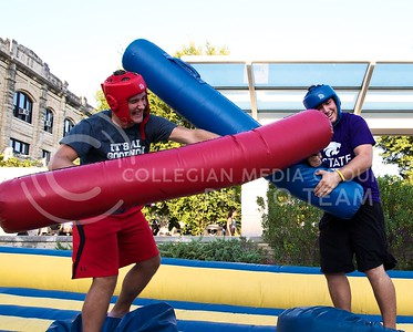 (Photo by Jed Barker | Collegian) Jacob Riggs (left), sophomore in mechanical engineering, and Anthony Fink, freshman in hotel and restaurant management, battle it out in the jousting ring during the 17th Street Fair at Bosco Plaza on August 27.  At the fair students enjoyed free food and an assortment of activities from bull riding to rock climbing.