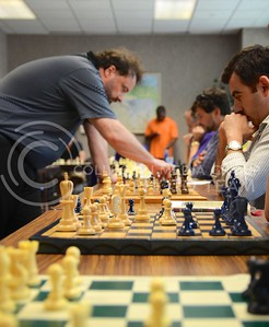 (Photo by Parker Robb | Collegian)  Jonathan Sarfati, former chess champion of New Zealand, attacks an opponent with a chess piece as he cycles through his sixteen concurrent games during the Creation Club's Chess Challenge at the K-State Student Union August 26. K-State students and Manhattan residents had the opportunity to challenge the chess master and subsequently improve as chess players.