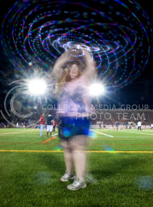 Hannah Erdman, sophomore in biology, dances with an LED hula hoop during the Late Night Breakfast pancake feed in Memorial Stadium on Saturday, August 24, 2013.