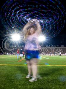 Hannah Erdman, sophomore in biology, dances with an LED hula hoop during the Late Night Breakfast pancake feed in Memorial Stadium on Saturday, August 24, 2013.