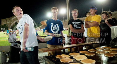 Hannah Hunsinger | Collegian  Luke Marx (left), freshman in business, gets fancy while catching pancakes at the Late Night Breakfast pancake feed in Memorial Stadium on Saturday, August 24, 2013.