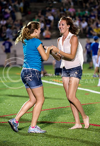 Darrah Tinkler (left), sophomore in psychology, and Naci Peters, junior in family studies practice their country swinging two-step during the Late Night Breakfast pancake feed in Memorial Stadium on Saturday, August 24, 2013.