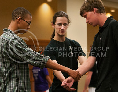 Dwayne Frazier (Left), Freshman in Architectural Engineering practices self-defense move on Jacob Woody (Right), Freshman in Accounting, in Tae-Kwon-Do class held at the Jardine Frith Community Center Wednesday night. This self defense class was taught by Sun Yi's Academy of Tae-Kwon-Do. (Photo by Zachary Werhan / The Collegian)