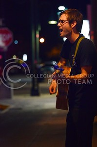 (Photo by Parker Robb | Collegian)  Guitarist Chance Muelder plays for passers-by on the streets of Aggieville Friday evening during the annual Aggiefest music festival. This year sixty bands representing genres from rock and metal to bluegrass, indie, synth and experimental performed during the two-day festival for K-State students and Manhattan residents at eight different Aggieville businesses.