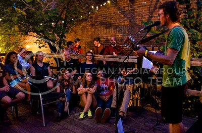 (Photo by Parker Robb | Collegian)  Folk/rock singer-songwriter Chris Riley Davis entertains family, friends and festivalgoers with his original compositions Friday evening at the Bluestem Bistro during the annual Aggiefest music festival. This year sixty bands representing genres from rock and metal to bluegrass, indie, synth and experimental performed during the two-day festival for K-State students and Manhattan residents at eight different Aggieville businesses.