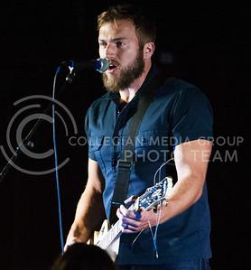 (Photo by Zach Werhan / The Collegian) Logan Mize sings at the Warehem during Thursday night Alli Kemp concert.