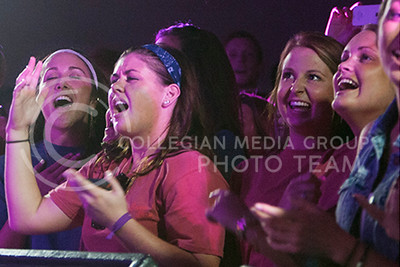 (Photo by Zach Werhan / The Collegian) Logan Mize fans sings along during Thursday nights Alli Kemp concert hosted by Soroity Pi Beta Phi. This event filled up the Warehem.