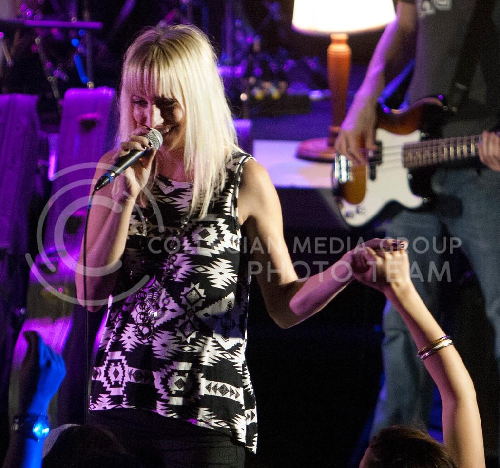 (Photo by Zach Werhan / The Collegian)<br /> Jill Mize sings along with her husband, Logan Mize, at Thursday night Alli Kemp concert.