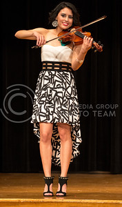 Valeria Guizado, sophomore in biology, plays the violin as her talent during the 2014 Bellaza Latina competition in the KSU ballroom on Saturday, April 19. Guizado went on to win the competition and be crowned 2014 Miss KSU Bellaza Latina.
