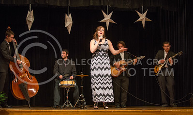 Monica Diaz-Serrano, sophomore in vocal performance and pre-psychology, singsin Spanish for the talent during the 2014 Bellaza Latina competition in the KSU ballroom on Saturday, April 19. Diaz-Serrano was awarded Miss Talent for her performance.