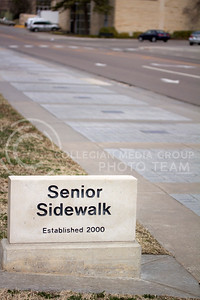 (Photo by Taylor Alderman | Collegian)    Senior Sidewalk is a feature on campus that many students walk on without even realizing it. Located at Denison and Anderson, the sidewalk offers K-State graduates to leave their mark as a legacy by allowing them to purchase a granite stone to by placed in the sidewalk.