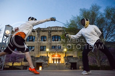 Parker Robb | The Collegian  Ethan Copeland, senior in microbiology, and Lucille Sadlon, sophomore in architecture, practice their fencing technique in Bosco Plaza April 21, 2014. With the temperature peaking at 79 degrees F midday Monday, many students were out and about enjoying the warm, pleasant evening weather.