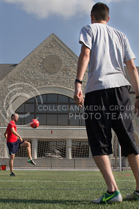 (Photo by Taylor Alderman | Collegian)  Pablo Coll, masters student in physics, passing a soccer ball to Richie Martell, may graduate. Coll and Martell are roommates and were also teammates on K-State's club soccer team.