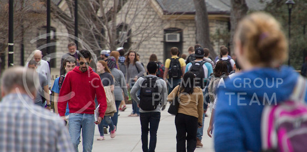 (Photo by Taylor Alderman | Collegian)   Students and professors walk to class in the afternoon on March 11, 2014. The Kansas Board of Regents has released how many students Universities in Kansas have accepted that do not meet minimal standards; while K-State has accepted 338 non-resident freshman exceptions, the next highest in Kansas is 107 from KU.